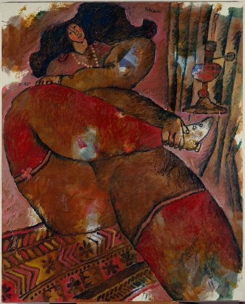 Femme assise sur un quilt