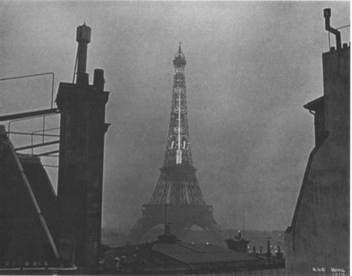 Ilse BING - Photography - Eiffel Tower with Thermometer at night, 1934