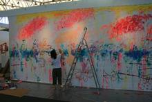 Ayako ROKKAKU - Photo - Ayako painting live at Art Amsterdam